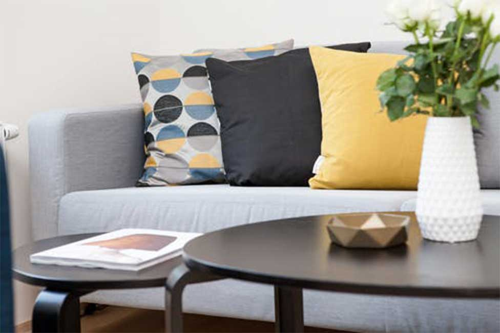 Photo of a fabric couch with pillows.