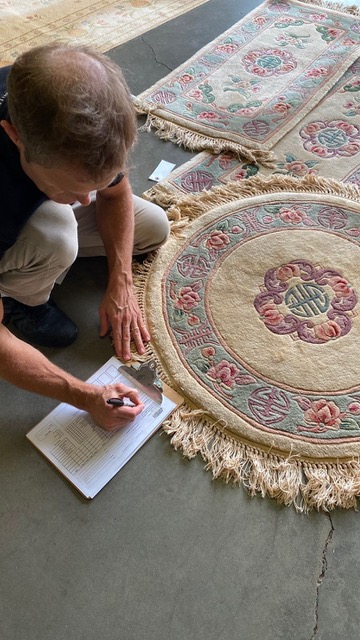 Mitch inspecting a rug