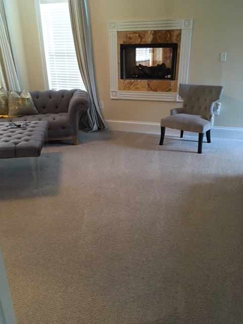 Large room with carpet that has been professionally cleaned.